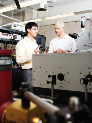Nanfang Yu (left) and Michael Weinstein in Yu's optics lab.