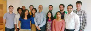 Riddhi Mehta MS'13 (third from left in blue top), pictured with Microsoft CEO Satya Nadella (center)