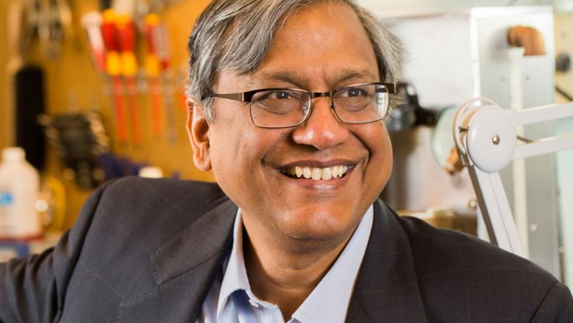 Portrait of Prof. Vijay Modi in the lab.