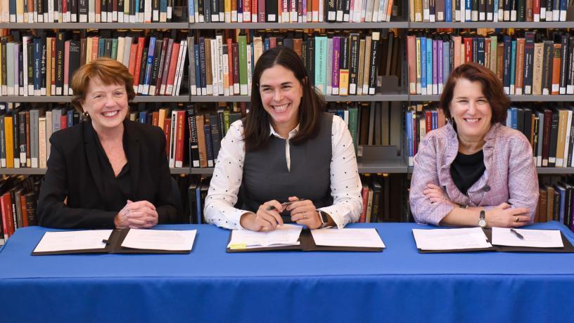 Dean Mary C. Boyce, Barnard President Sian Leah Beilock, and Barnard Provost Linda Bell formalizing the partnership.