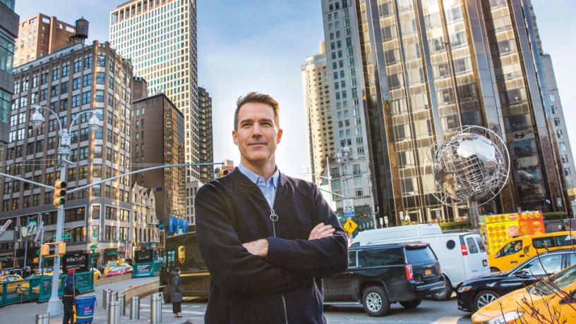 Prof. Andrew Smyth at Columbus Circle with traffic in the background.