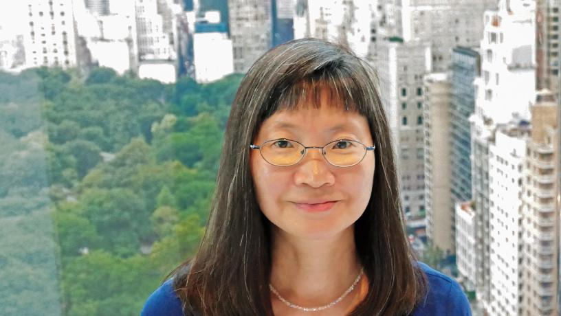 Portrait of Elizabeth Tom with Central Park in the background.