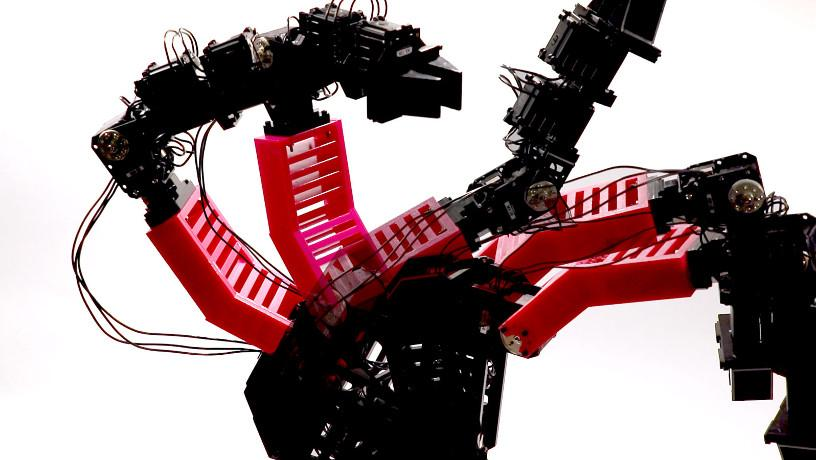 Image of the robotic arm in multiple poses while collecting data through random motion.