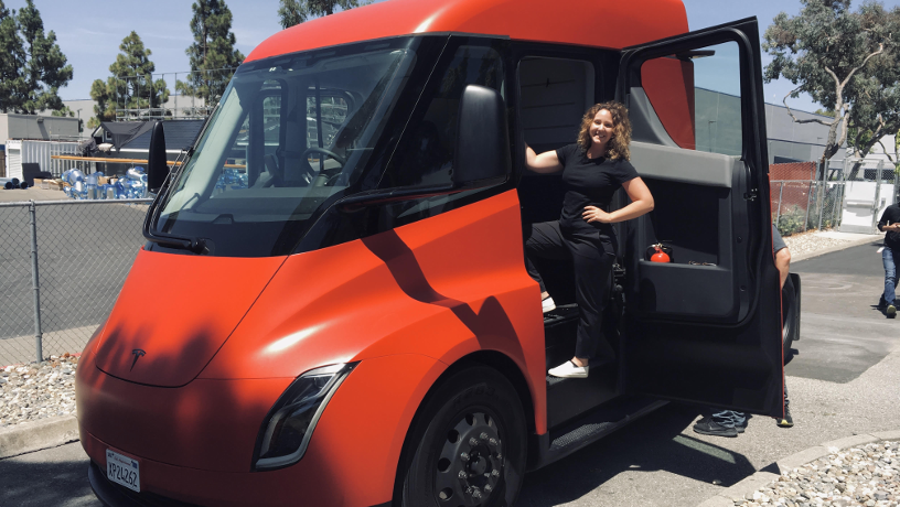 Picture of Christie Taylor in a Tesla Semi cabin.