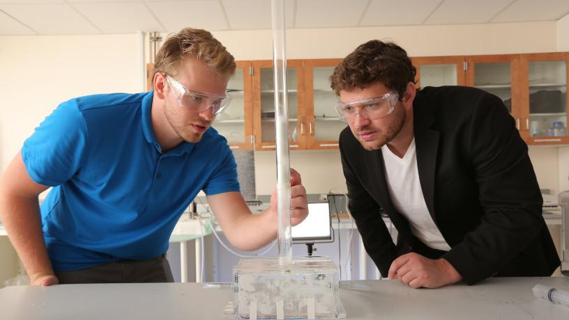 Prof. Chris Boyce working with a student in his lab.