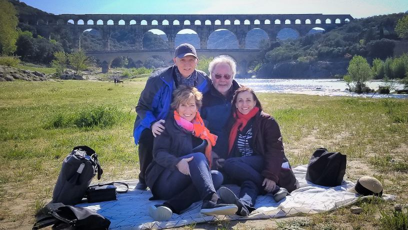 William Hooper with classmate Roger Liwer and their spouses in France with the Pont du Gard aqueduct in the background.