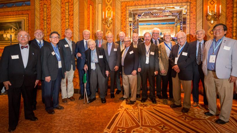 Members of the Golden Lions posing for a group picture in the Russian Tea Room.
