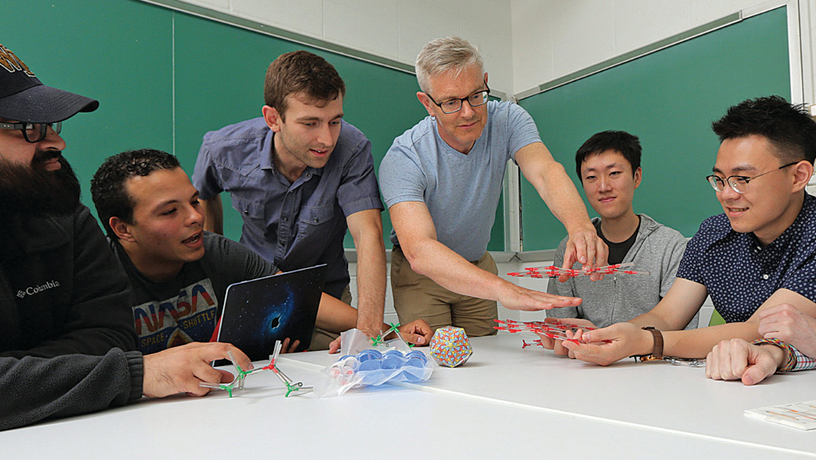 Prof. Simon Billinge working with students and researchers in his lab.