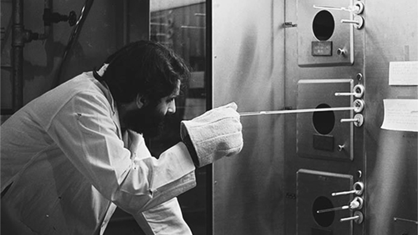 Black and white picture of Tsividis as a graduate student working in a lab at Berkeley.